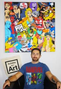 Le geek artiste Romain Dorez devant sa toile Adopte une oeuvre